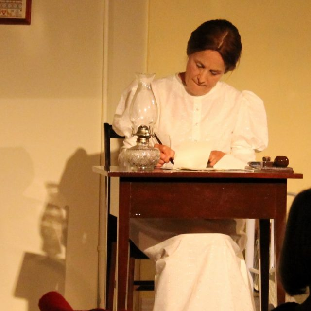 Joan as Emily Dickinson at her writing table