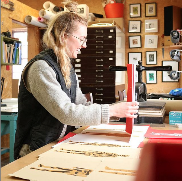 Artist-in-residence Phoebe Todd-Parrish working in the Print Shop.