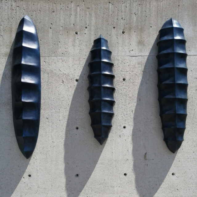 Wall Sculpture Trio No.8, No.9, No.10, cast Winterstone with integrated bronze, patinated